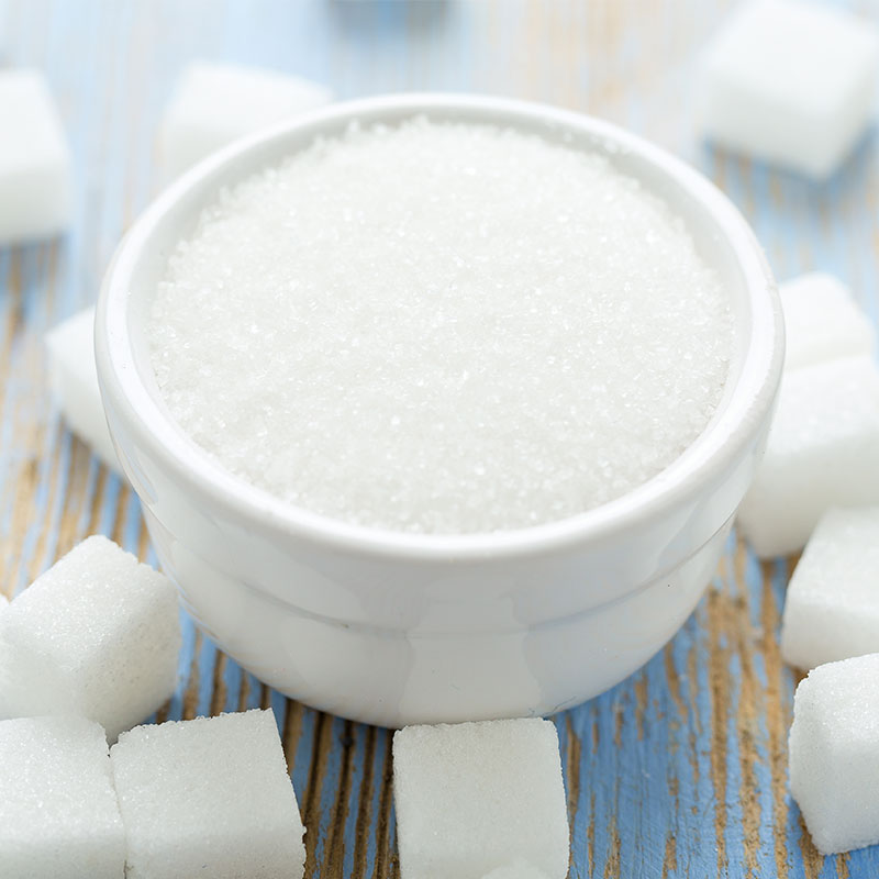 Bowl of sugar with sugar cubes with vending machines