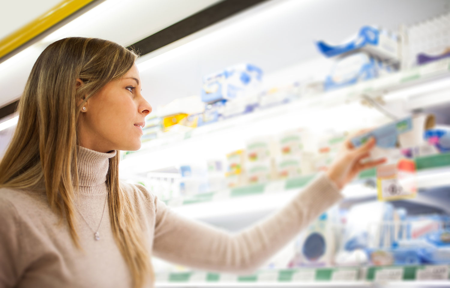 Woman choosing a healthy snack option from a micro-market and vending machine